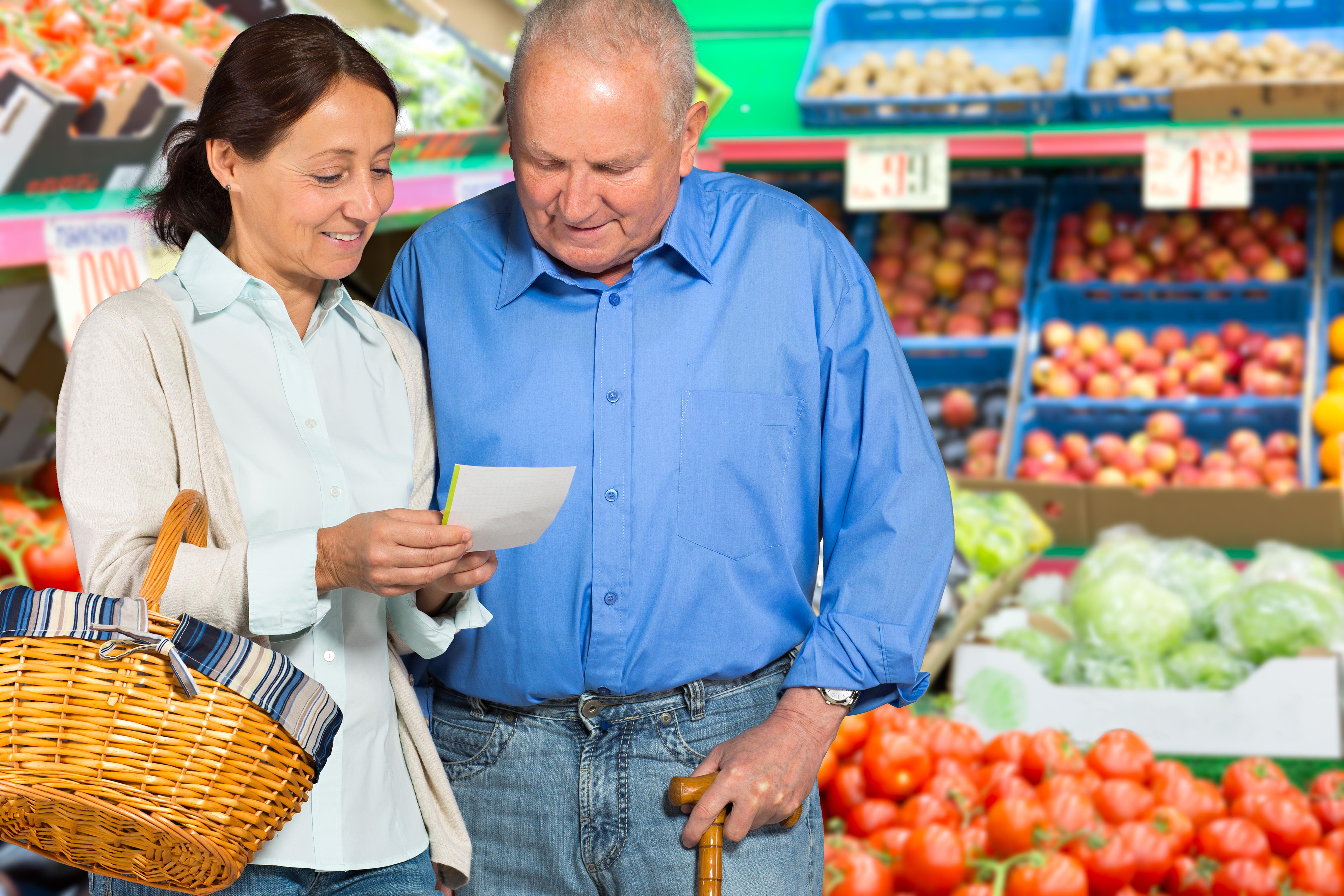 Senior man with caregiver shopping
